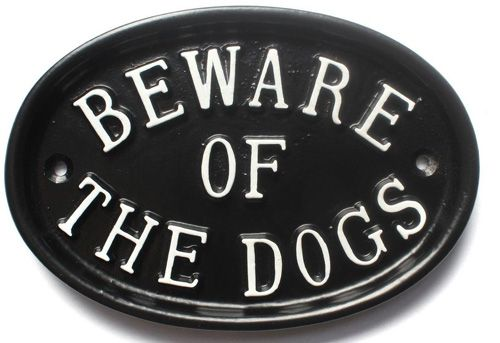BEWARE OF THE DOGS large oval sign
